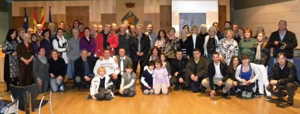 La vuitantena de colles i entitats participants a la Festa Major d'Hivern, homenatjades